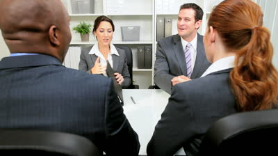 stock-footage-young-business-people-presenting-business-plan-to-banking-executives-for-consideration